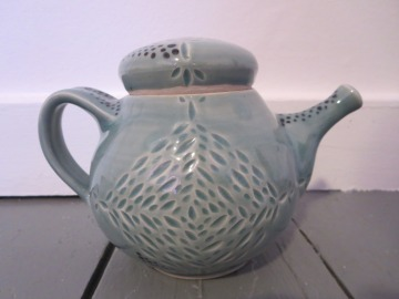 thrown blue teapot