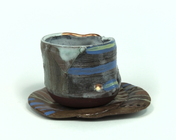 "Cup and saucer 2014 3.25"" x 4"" x 4"" Handbuilt and thrown earthenware with stain and glaze fired to cone 2 and china paint"